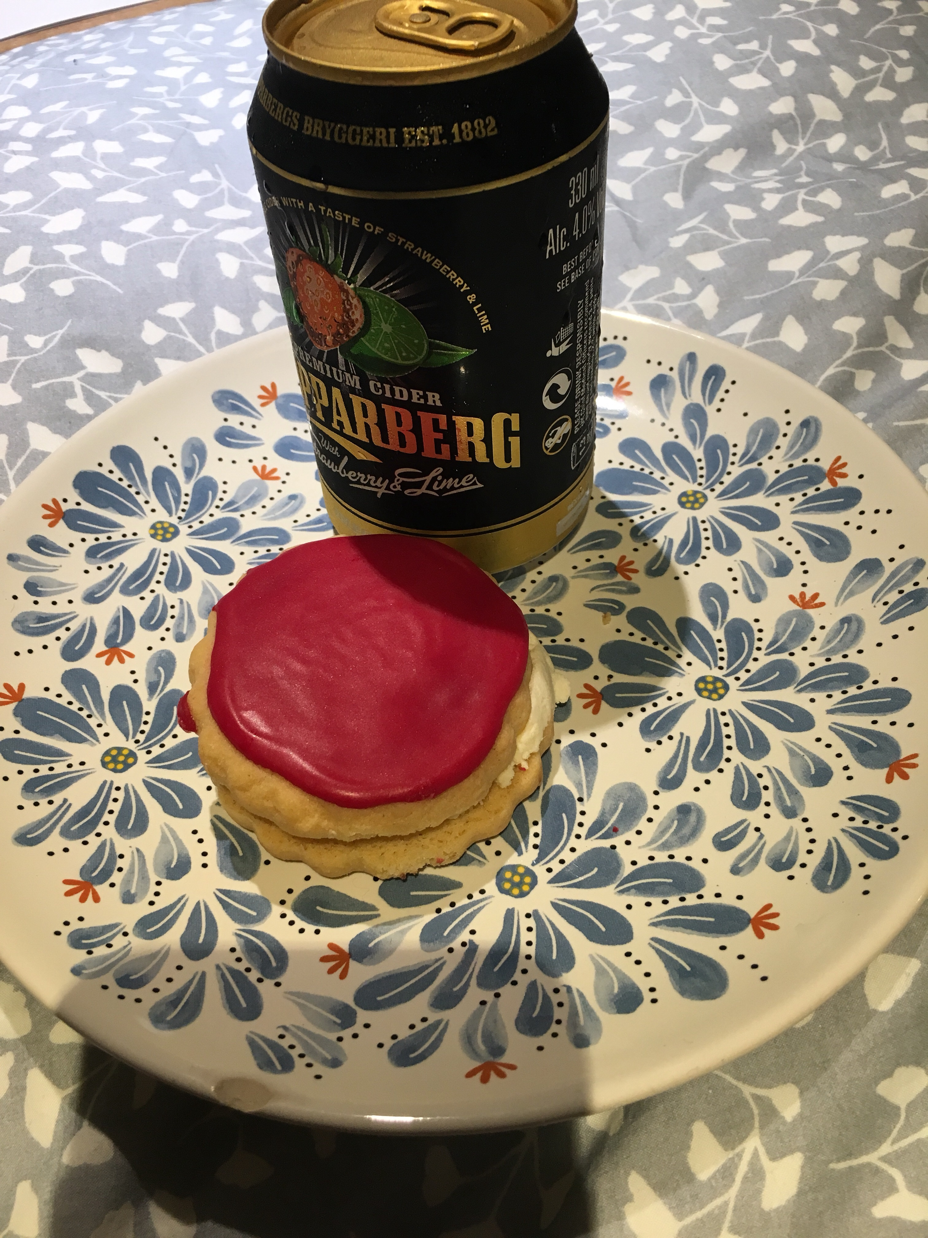 Pink biscuit and cold can of cider